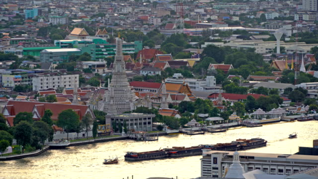 Temple of Dawn with Chao Phraya River at sunset in Bangkok City, Thailand. Buddhist temple. 4K cityscape VDO Temple of Dawn with Chao Phraya River at sunset in Bangkok City, Thailand. Buddhist temple. 4K cityscape VDO southeast stock videos & royalty-free footage