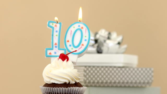 Ten 10 candle in cupcake pastel background