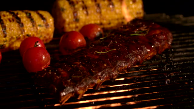 Tender ribs, tomatoes and corn grilling on a barbecue video