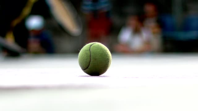 Tennis ball on the ground