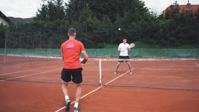 tennis coach having a lesson with his client - target australia stock videos & royalty-free footage