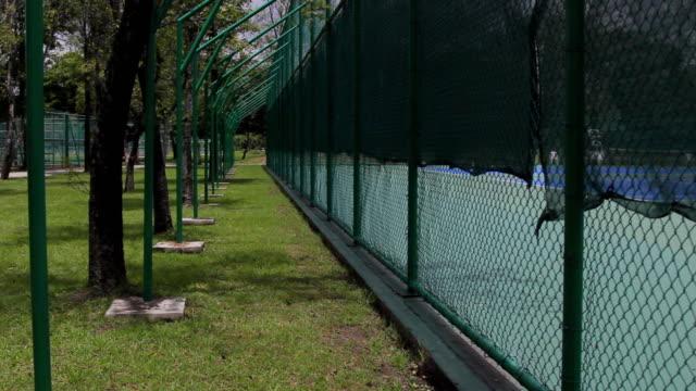 Tennis court fence close.