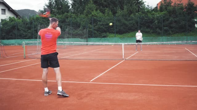 tennis player having a lesson with a tennis coach - target australia stock videos & royalty-free footage