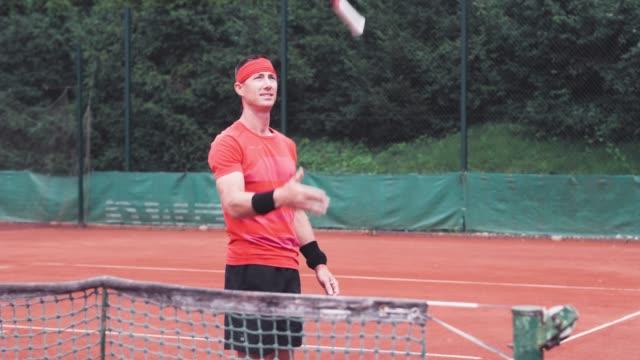 tennis player having some fun with tennis racket - target australia stock videos & royalty-free footage