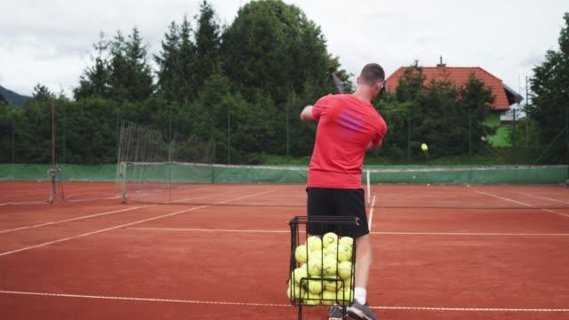 tennis player practicing his stroke - target australia stock videos & royalty-free footage
