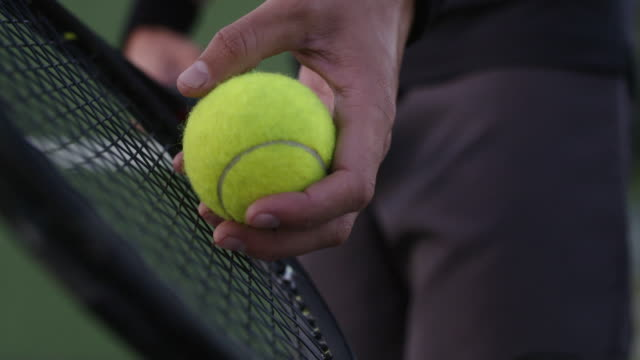 Tennis player ready to serve Close up of hands of male player holding racket and preparing to serve tennis ball. Tennis player ready to serve in the game. teknik stock videos & royalty-free footage