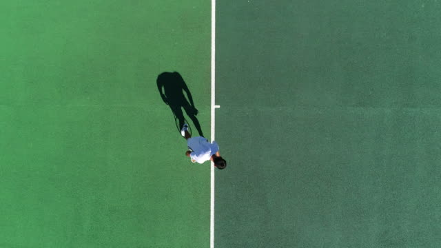 Video A Tennis Player serves from above and celebrates an ace.