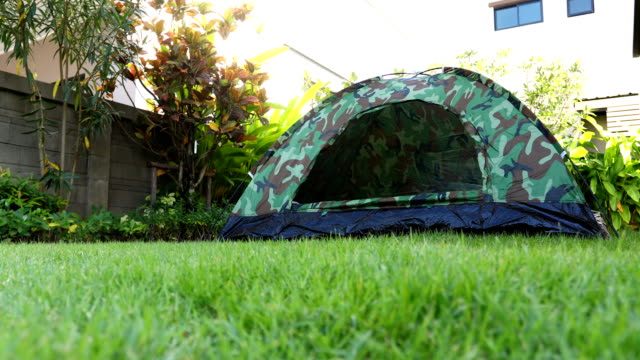 Tent camping Tent camping ornamental garden stock videos & royalty-free footage