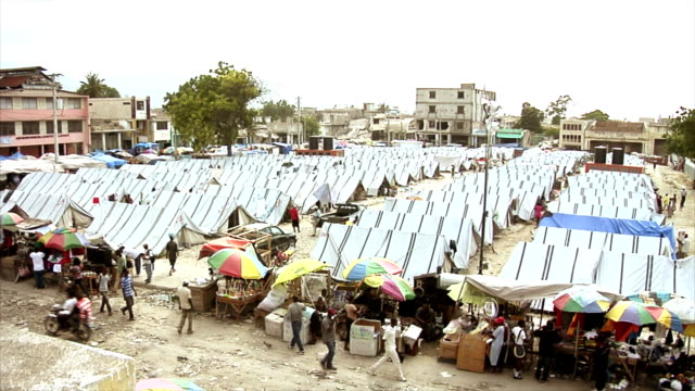 Tent City of Earthquake Survivors A tent city of earthquake survivors in the middle of Port-au-Prince Haiti  earthquake stock videos & royalty-free footage
