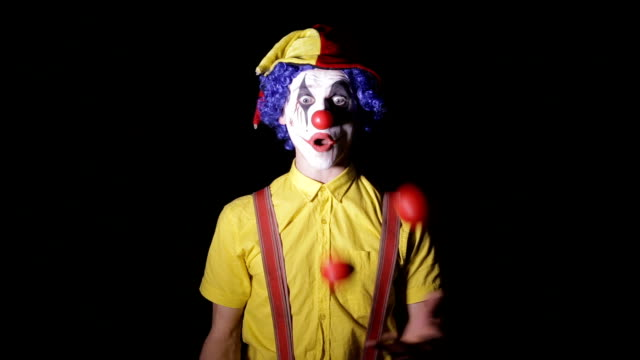 Terrible horror clown. Scary mad Juggler clown using juggling pins video
