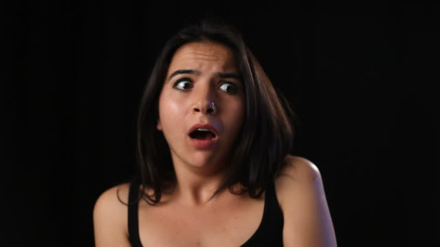 Terrified young woman in dark video