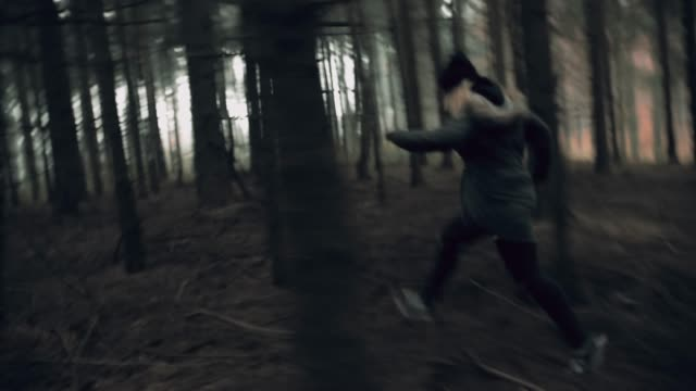 Terrified young woman running for her life video
