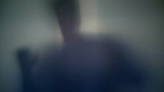 Terrifying male silhouette emerging, flashing, scary gestures video