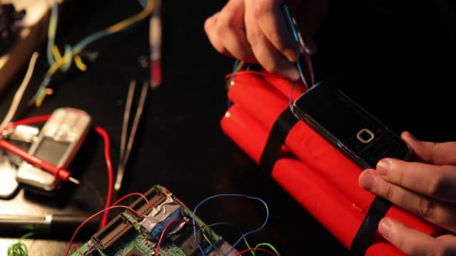 Terrorist constructing a dynamite bomb in workshop