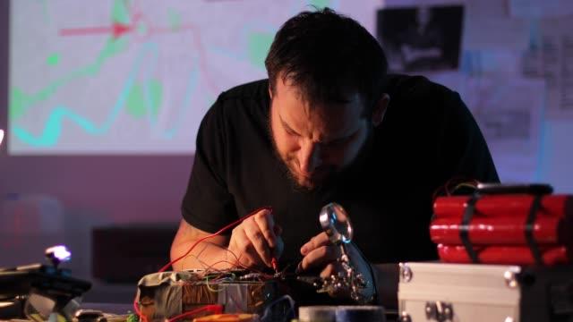 Terrorist making a bomb in workshop