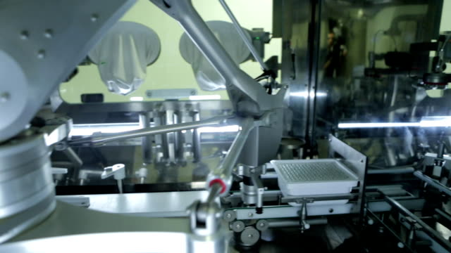 test tubes on robotic conveyor - medical equipment stock videos and b-roll footage
