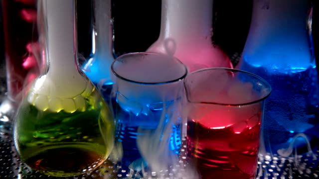 test tubes with chemical liquid in laboratory,on a black background - chemistry stock videos and b-roll footage