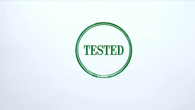 Tested seal stamped on blank paper background, approved results, examination