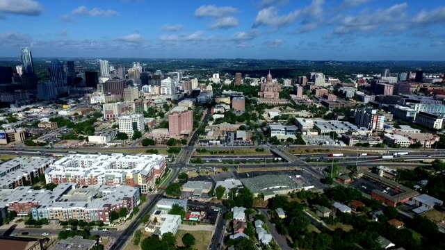 Texas State Capitol Seen with Cityscape and Interstate-35 Texas Hill Country Austin Texas Texas State Capitol Seen with Cityscape and Interstate-35 Texas Hill Country Austin Texas Aerial Drone view over Urban ATX morning hours with large cloud passing over Downtown east stock videos & royalty-free footage