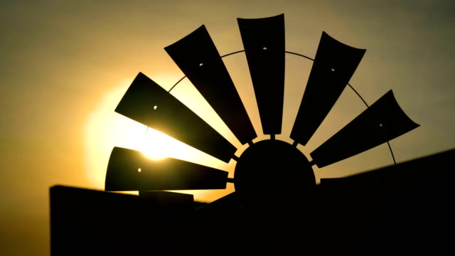 Texas Wind Mill at Golden hour sunset Texas Wind Mill at Golden hour sunset light beams coming through the blades texas stock videos & royalty-free footage