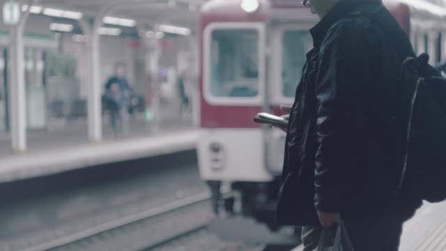 Text messaging on smartphone A man With Smartphone Travelling By Subway subway platform stock videos & royalty-free footage