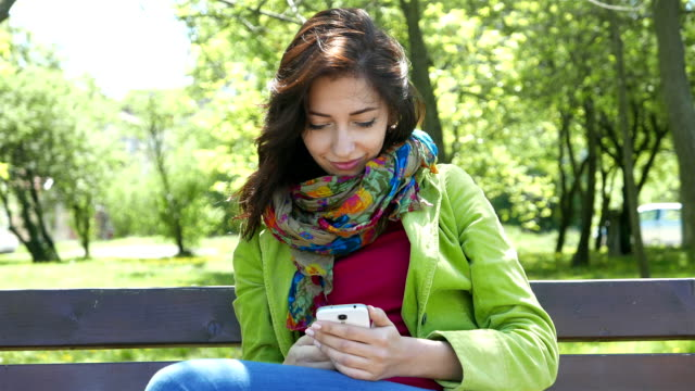 Texting on a cell phone in the park video