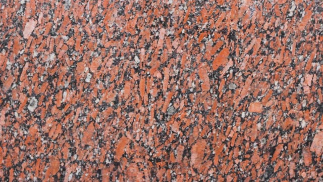 texture of red granite slabs. stone nature pattern . decorative geology surface