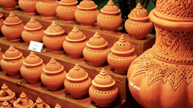 Thai ancient incense pot. Thai ancient style incense pot for aromatherapy and spa, sale in native market.Thai text in clip mean price of one pot. souvenir stock videos & royalty-free footage