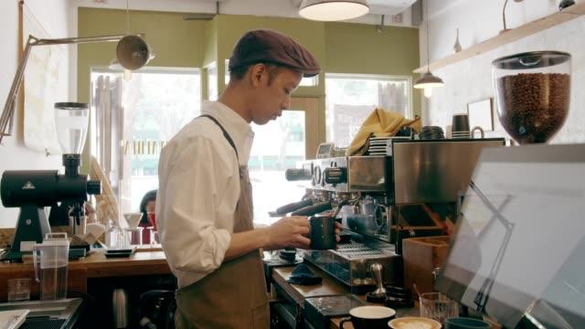 Thai barista man doing hot caffucino process video