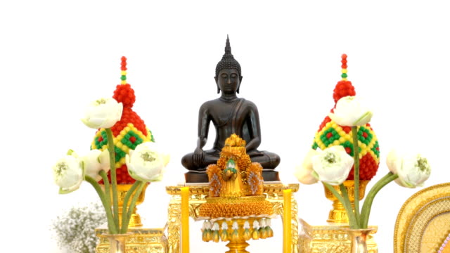 4K Thai buddha statue with candle on white background