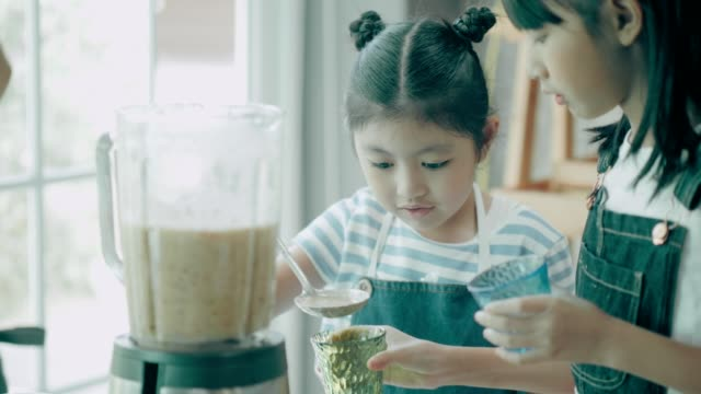 Thai elementary students and friends learning cooking in the kitchen video