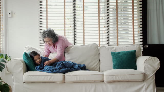 Thai Families at Home:Grandmother take care of cover granddaughter with a blanket video