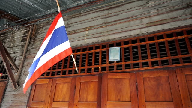 Thai flag hanging above door home Thai flag hanging above door home expressionism stock videos & royalty-free footage