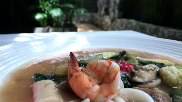 Thai food , fried noodle top with seafood cream soup video