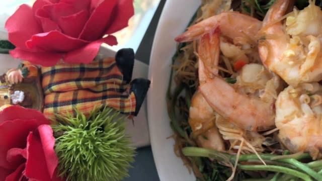 Thai fusion food , mild spicy fried noodle with shrimp and  Water Mimosa , vertical clip for smartphone
