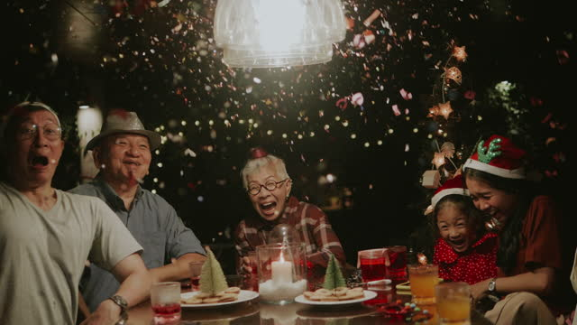 Thai hipster family celebrating Christmas new year at home