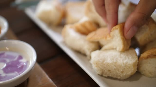 thai steam bread with dipping sweet sauce - immergere video stock e b–roll
