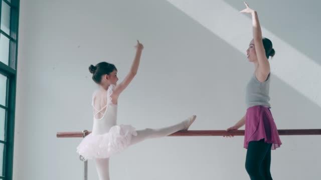 Thai teacher and her cute ballerina girl with ballet dancing class