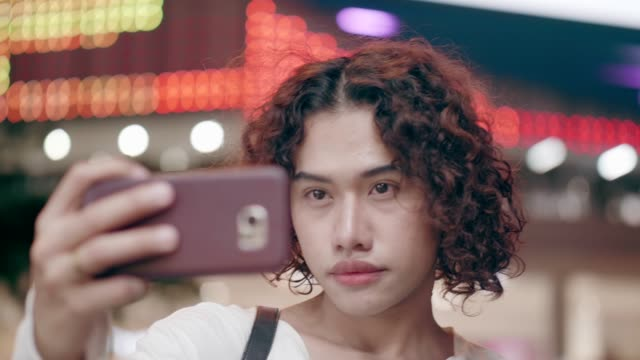 Thai transgender traveling in the city on weekend before new year video