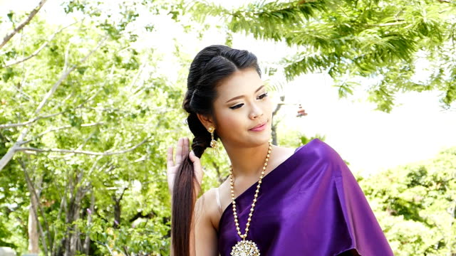 Thai woman dressing traditional. video
