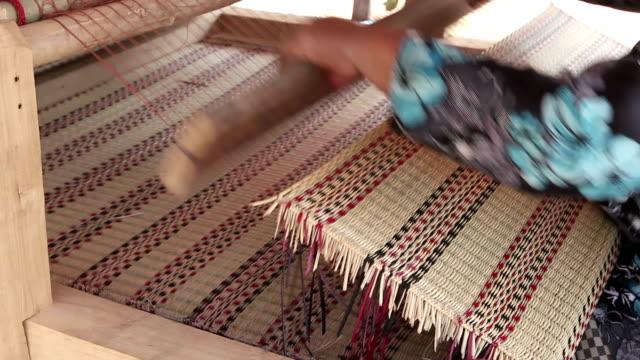 Thai woman hands weaving reed mat video HD. video
