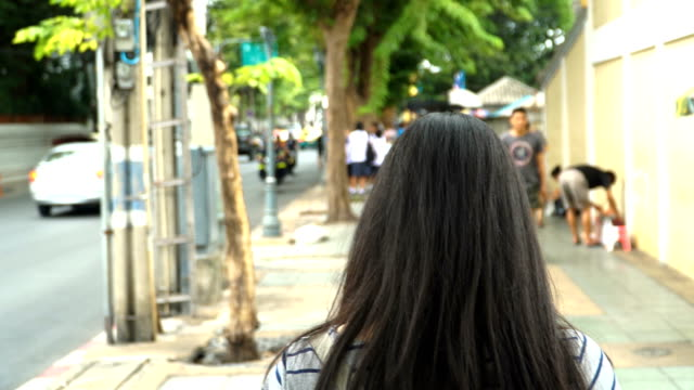 Thai woman pedestrian walking in Bangkok, Thailand video