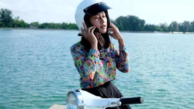 Thai women driving retro scooter