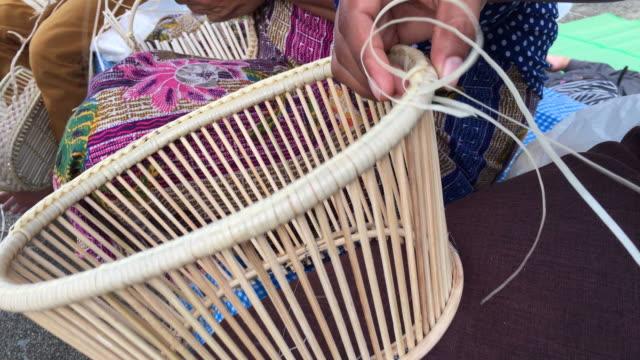 Thai women weaving making wicker basket video