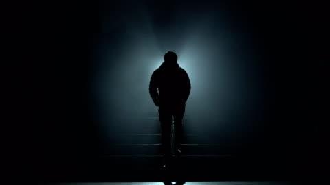 vídeos de stock e filmes b-roll de thai young man come straight to light in nightmare - escuro