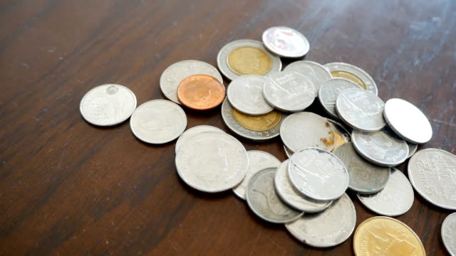 Thailand coins on wood floor video