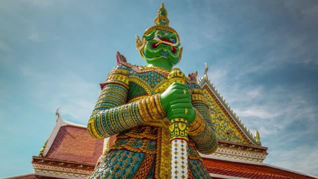 thailand day famous wat arun bangkok temple demon guardian 4k time lapse video