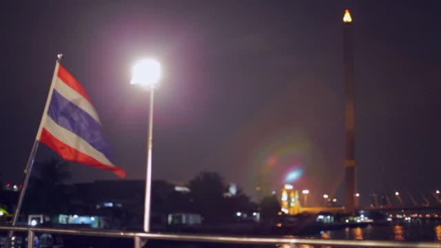 thailand flag on chao phraya river - fiume chao phraya video stock e b–roll