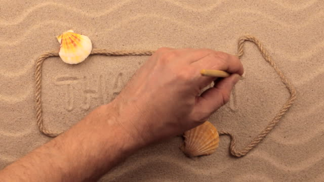 Thailand inscription written by hand on the sand, in the pointer made from rope. video