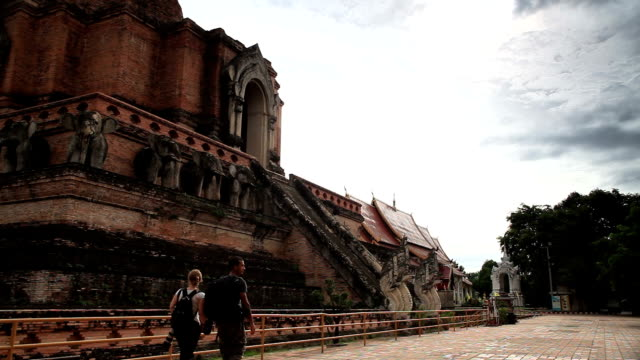Thailand Temple Chiang Mai Wat Chedi Luang. Tourists walking video